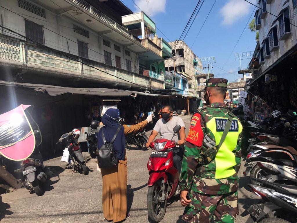 Cegah Penyebaran Covid-19, Babinsa Laksanakan Patroli Gabungan Yustisi