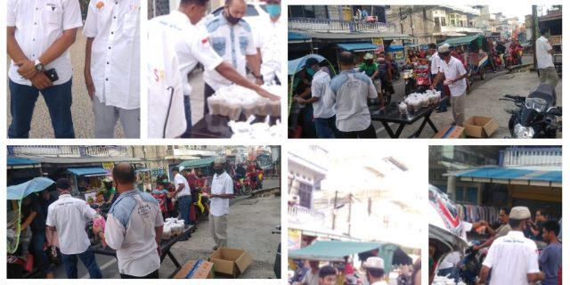 Sahabat Haji Asmar Berbagi Takjil Dan Masker
