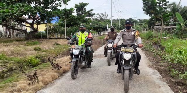 Cegah Karlahut, Babinsa dan Babinkatibmas Rutin Laksanakan Patroli di Rawan Kebakaran